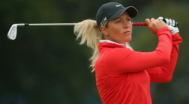 Suzann Pettersen plays an approach shot during the first round of the Australian Open. Pettersen fired a 6-under 66 to take the first-round lead.