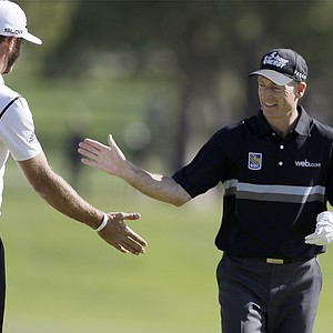 Dustin Johnson, left, and Jim Furyk during the first round of the PGA Tour's 2014 Northern Trust Open at Riviera near Los Angeles.