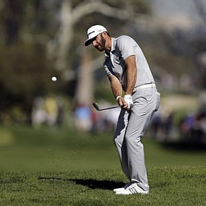 Dustin Johnson hits a chip shot on the fourth hole during the second round of the Northern Trust Open at Riviera Country Club.