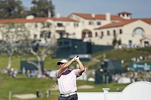 Robert Garrigus tees off on the 14th hole during the second round of the Northern Trust Open at Riviera Country Club.