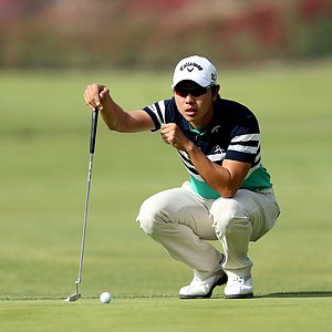 Sang-Moon Bae lines up his putt on the first green in the third round of the Northern Trust Open at Riviera CC.