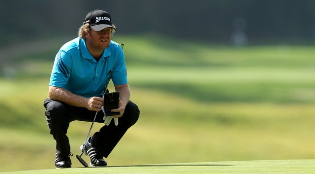 William McGirt reads his putt on the eighth hole in the third round of the Northern Trust Open.