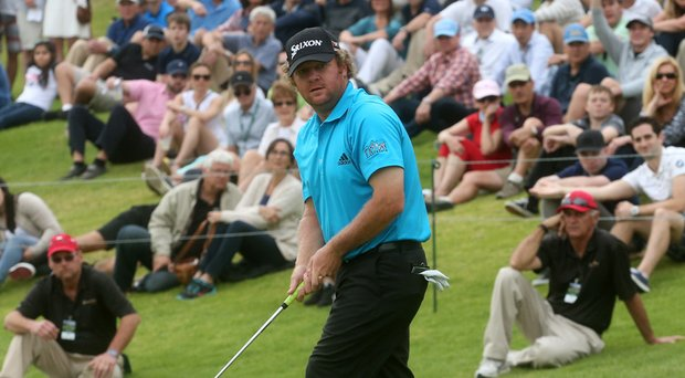 William McGirt reacts as he misses a birdie putt attempt on the 18th green in the third round of the Northern Trust Open