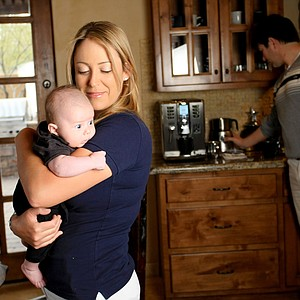 Cristie Kerr and Erik Stevens with their baby Mason at home in Scottsdale, Arizona.