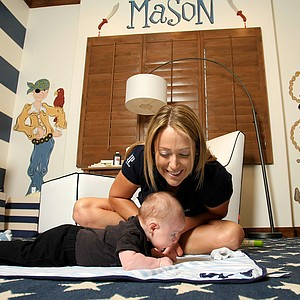 Cristie Kerr enjoys some time with her baby Mason at her home in Scottsdale, Arizona.
