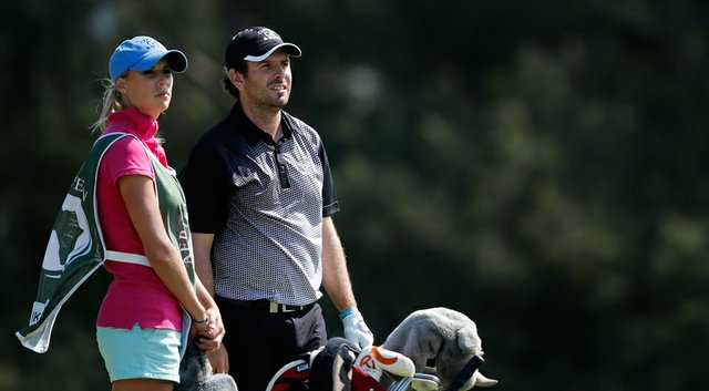 Thomas Aiken with his caddie and wife, Kate, during the third round of his win at the European Tour's 2014 Africa Open.