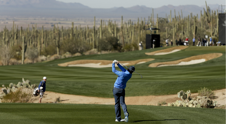 Rory McIlroy plays the 11th hole at Dove Mountain during the 2013 WGC Match Play.