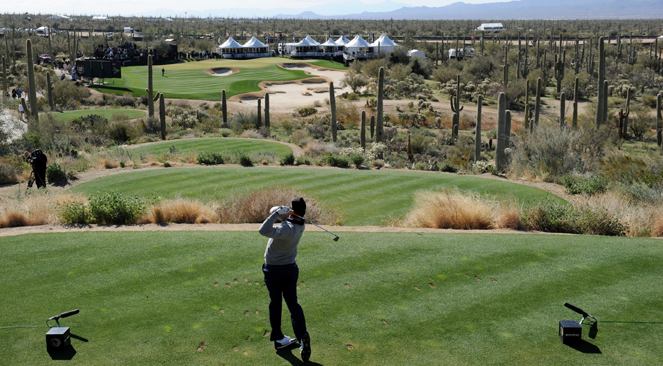 Hunter Mahan plays the 12th hole at Dove Mountain during the 2013 WGC Match Play.