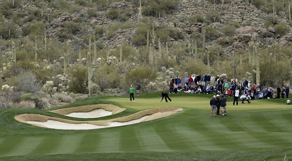 Charles Howell III and Tiger Woods read putts at the 14th hole at Dove Mountain during the 2013 WGC Match Play.