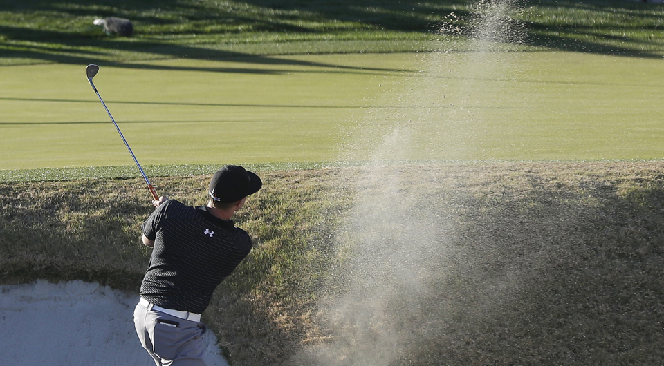 Hunter Mahan plays the 16th hole at Dove Mountain during the 2013 WGC Match Play.