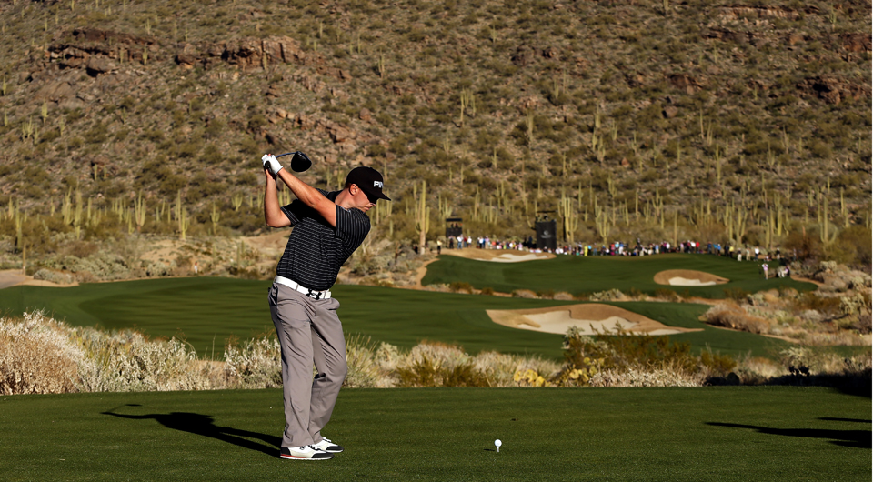 Hunter Mahan plays the 17th hole at Dove Mountain during the 2013 WGC Match Play.