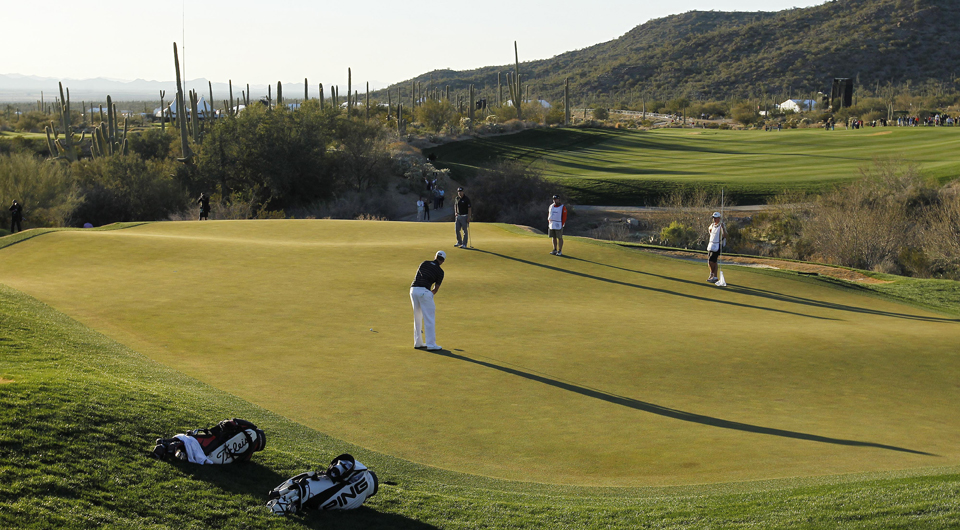 Webb Simpson plays the 18th hole at Dove Mountain during the 2013 WGC Match Play.