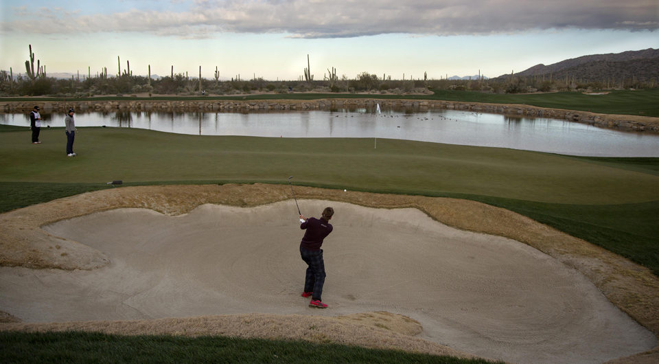 Ian Poulter plays the third hole at Dove Mountain during the 2013 WGC Match Play.