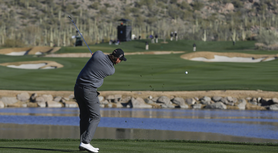 Nicolas Colsaerts plays the fourth hole at Dove Mountain during the 2013 WGC Match Play.