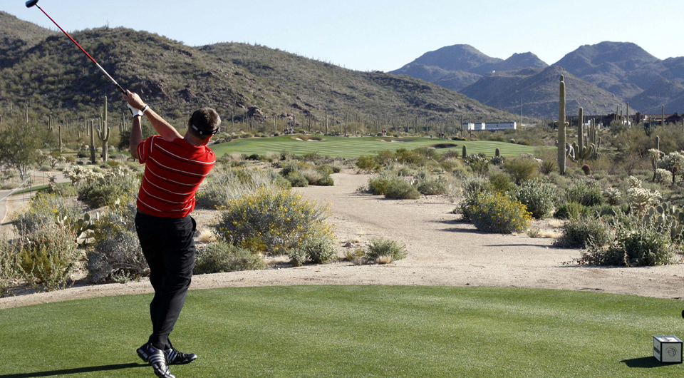 Robert Allenby plays the ninth hole at Dove Mountain during the 2010 WGC Match Play.