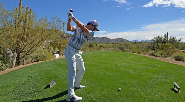 Rory McIlroy plays a shot during practice prior to the start of the WGC-Accenture Match Play at the Golf Club at Dove Mountain.