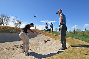Richard Sterne and coach Jamie Gough during Tuesday practice for the PGA Tour's 2014 WGC-Accenture Match Play at Dove Mountain in Marana, Ariz.