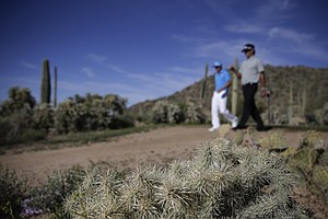 Rickie Fowler and Bubba Watson during Tuesday practice for the PGA Tour's 2014 WGC-Accenture Match Play at Dove Mountain in Marana, Ariz.
