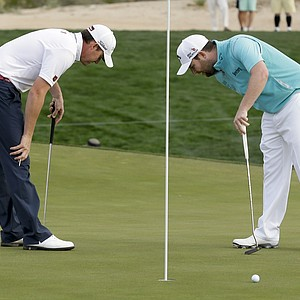 Jimmy Walker and Brandon Grace checking out a hole at the WGC Match Play 2014