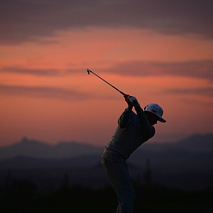 Rickie Fowler hits a practice shot prior to the first round of the WGC-Accenture Match Play Championship at The Golf Club at Dove Mountain.