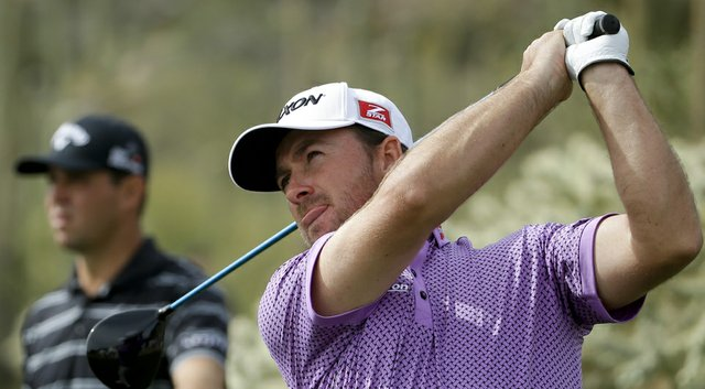 Graeme McDowell, right, after his win over Gary Woodland, left, in the first round of the 2014 WGC-Accenture Match Play at Dove Mountain in Marana, Ariz.