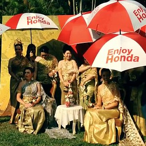 LPGA players dressed in traditional Thailand attire for the Honda LPGA Thailand tournament