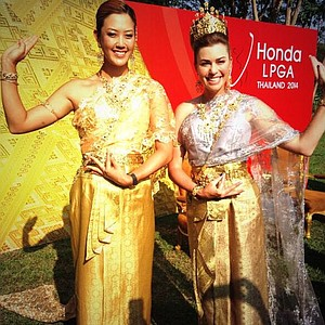 Michelle Wie and Paula Creamer in traditional Thailand garb at the Honda LPGA Thailand tournament
