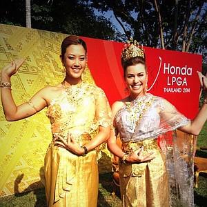 Michelle Wie and Paula Creamer in traditional Thailand garb at the Honda LPGA Thailand tournament