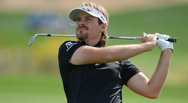 Victor Dubuisson defeated Bubba Watson on Friday to advance to Saturday's quarterfinals at the WGC-Accenture Match Play Championship.