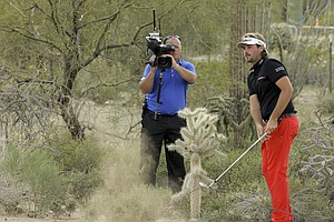 Victor Dubuisson hits a recovery shot from up against a cactus and goes on to save par on the first playoff hole of the 2014 WGC-Accenture Match Play before losing to Jason Day.