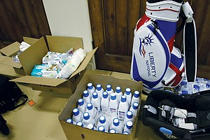 Cristie Kerr's new gear - diapers, formula and a baby seat - won't fit in the golf bag but travels with the new threesome.