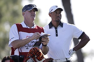 Tiger Woods and caddie Joe LaCava during pro-am day at the PGA Tour's 2014 Honda Classic at PGA National in Palm Beach Gardens, Fla.