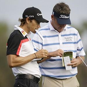 Camilo Villegas, left, and Jason Bohn during Thursday's first round of the PGA Tour's Honda Classic at PGA National in Palm Beach Gardens, Fla.