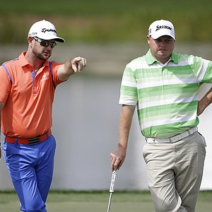 Rory Sabbatini, left, and Ted Potter Jr. during Thursday's first round of the PGA Tour's Honda Classic at PGA National in Palm Beach Gardens, Fla.