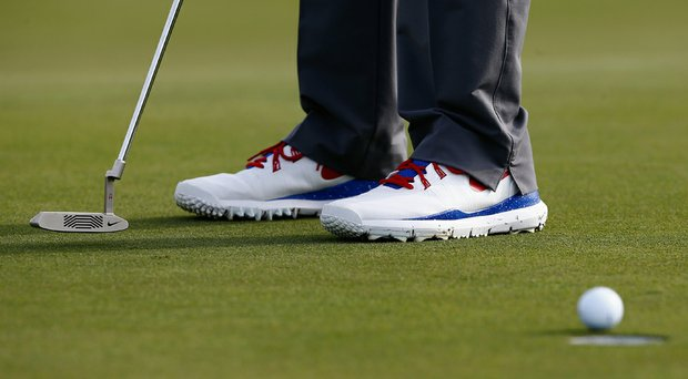 Tiger Woods wore red, white and blue golf shoes on Thursday during the first round of the Honda Classic.