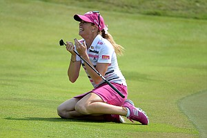 Paula Creamer celebrates making a 75-foot eagle putt on the second playoff hole to beat Azahara Munoz, winning her first LPGA title since the 2010 U.S. Women's Open.