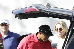 Tiger Woods after he withdrew during Sunday's final round at the PGA Tour's 2014 Honda Classic at PGA National in Palm Beach Gardens, Fla.