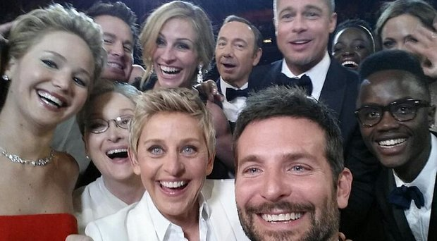 "2014 Academy Awards host Ellen DeGeneres (front left) is surrounded by Hollywood stars including Bradley Cooper (front center), who took the ""selfie"" that garnered millions of retweets."