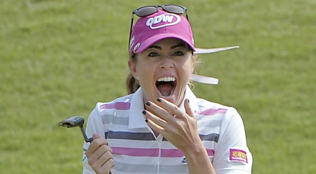 Paula Creamer of the LPGA reacts to her winning 75-foot eagle putt at the 2014 HSBC Women's Champions in Singapore.