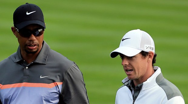 Tiger Woods, left, has been supplanted by Rory McIlroy as the oddsmakers' favorite in Doral at this week's WGC-Cadillac Championship on PGA Tour (shown here at this year's Dubai Desert Classic).