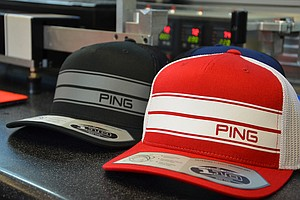Ping's staff players will be wearing these special hats at Doral. The racing stripes match the strips on the crown of the new i25 woods.
