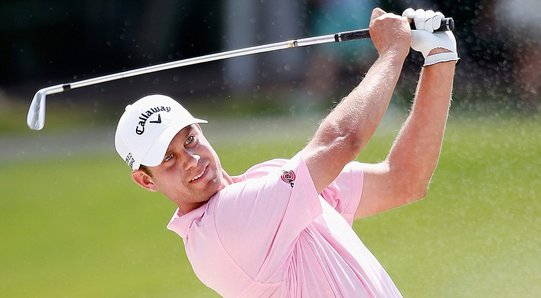 Harris English shot 3-under 69 to take the clubhouse lead Thursday at the WGC-Cadillac Championship.