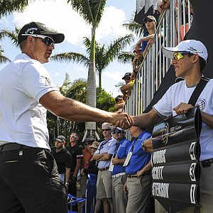 Henrik Stenson greets a standard bearer before the start of the second round of the WGC-Cadillac Championship at Trump National Doral.