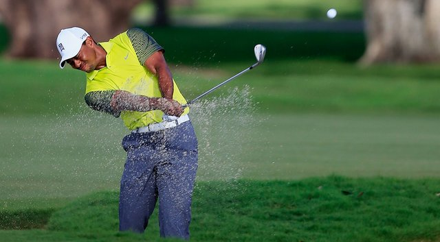 Tiger Woods during the completion of his first round Friday at the WGC-Cadillac Championship at Trump National Doral.