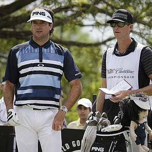 Bubba Watson and caddie Ted Scott at Trump National Doral's renovated Blue Monster course during Sunday's final round of the 2014 WGC-Cadillac Championship.