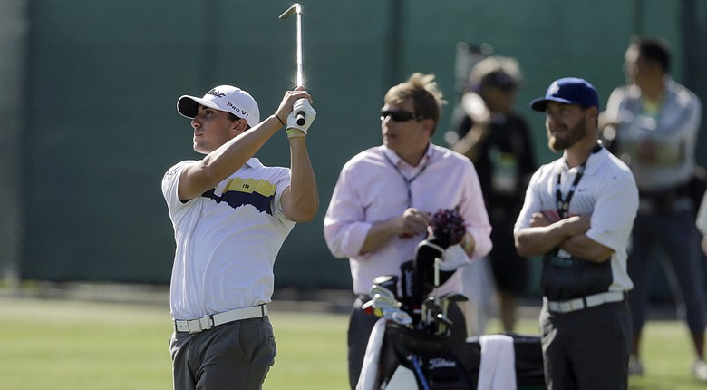 Max Homa, left, with caddie Joe Greiner, right, finished the final round of the 2014 Puerto Rico Open in less than two hours – near a PGA Tour record (shown here during practice at the Northern Trust Open).
