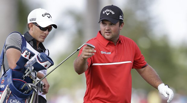 Patrick Reed with caddie Kessler Karain during his win at the 2014 WGC-Cadillac Championship, his third PGA Tour victory.