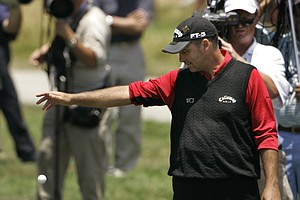 Rocco Mediate takes a costly drop during the  storied Monday playoff in the 2008 U.S. Open at Torrey Pines -- eventually losing Tiger Woods, who battled a knee injury en route to his most recent major victory.