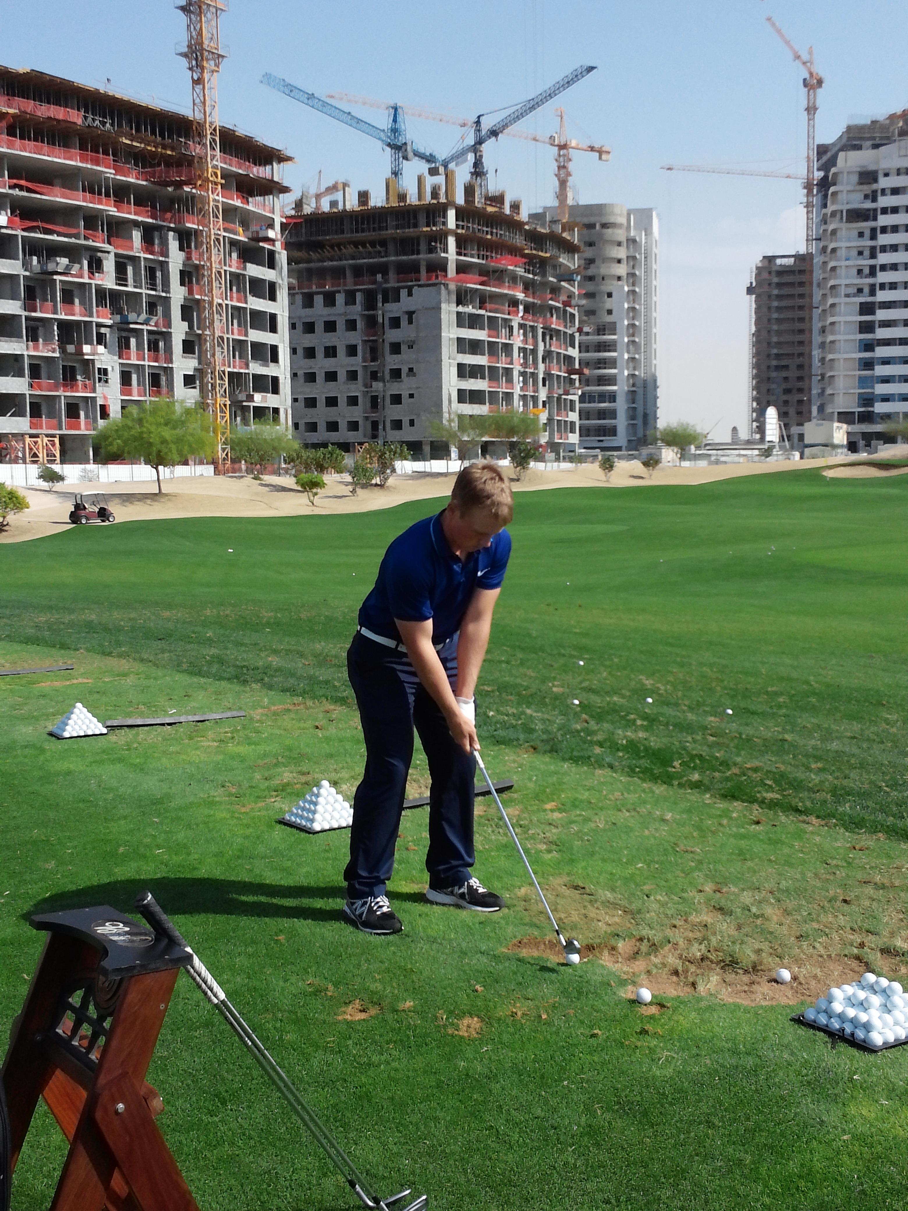 Brad Dalke practices at the Butch Harmon School of Golf in Dubai.