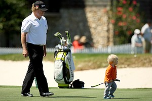 Will McGirt with his son on the practice putting green at the Arnold Palmer Invitational on Tuesday Bay Hill Lodge and Club.
